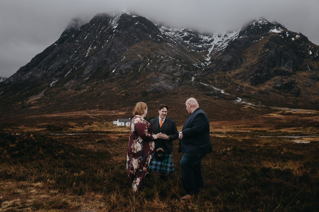 Handfasting ceremony during romantic winter Glencoe adventure elopement