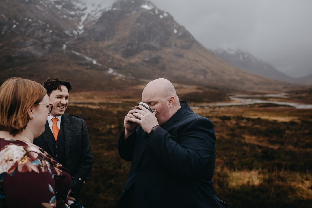 Drinking from quaich for handfasting ceremony during Glencoe adventure elopement