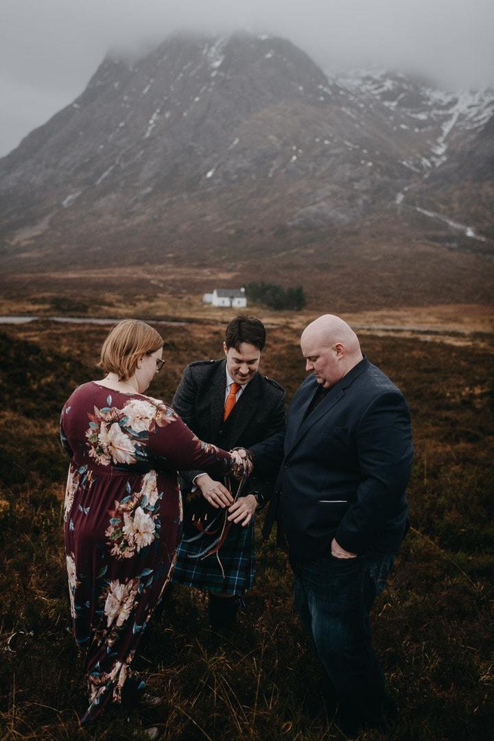 Romantic handfasting in Glencoe during wedding anniversary photoshoot in Scottish Highlands