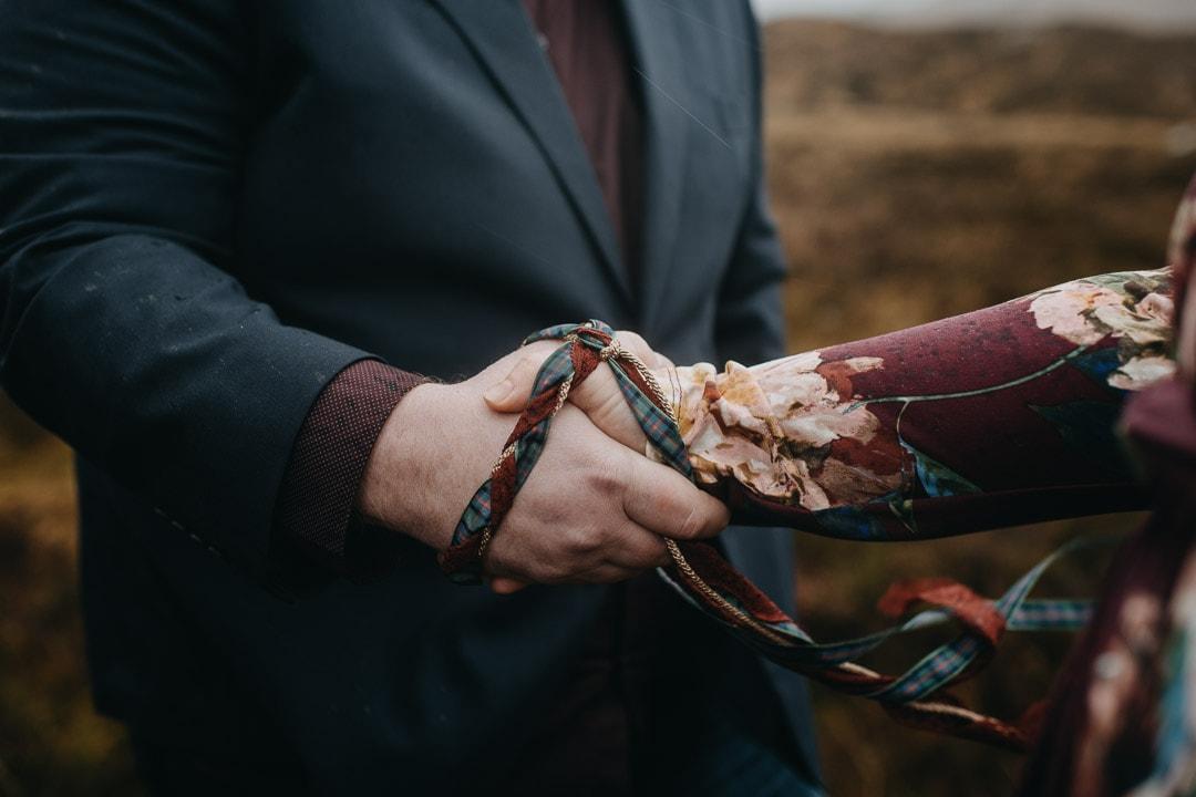 Romantic handfasting cord in Glencoe during wedding anniversary photoshoot in Scottish Highlands