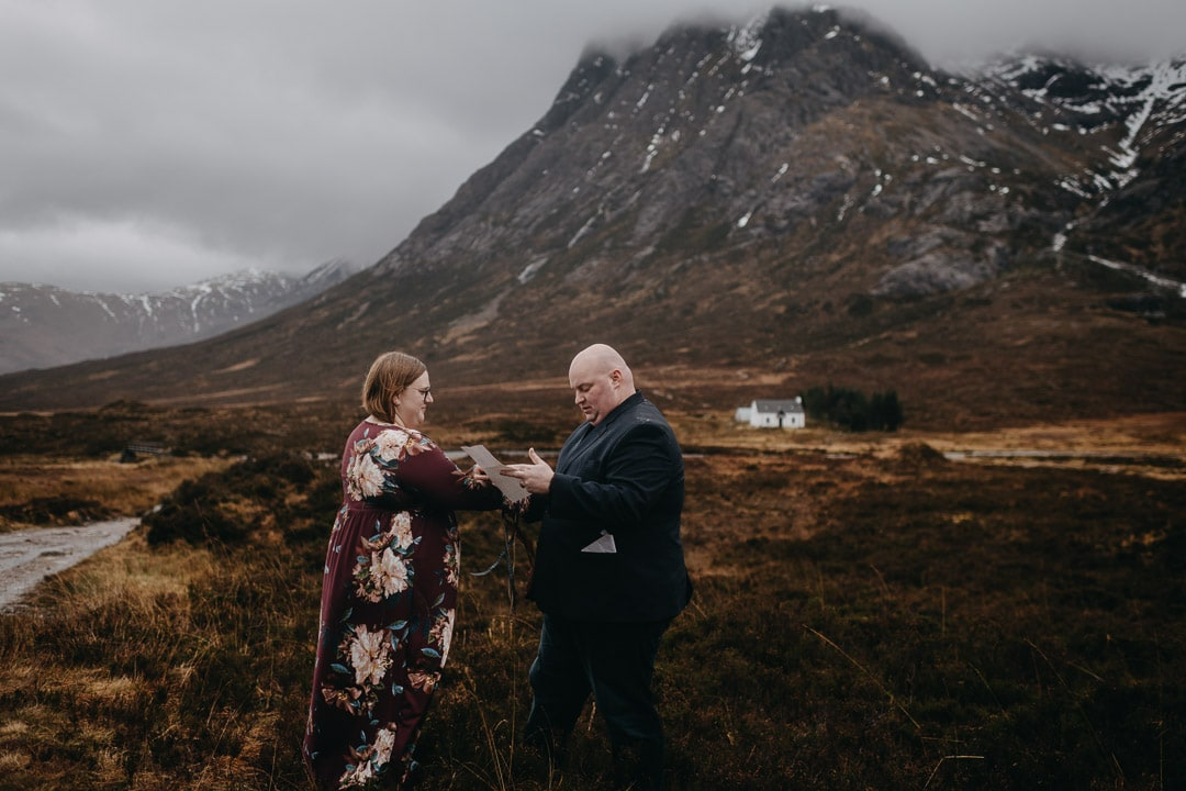 Romantic handfasting in Glencoe during wedding anniversary photoshoot in Scottish Highlands