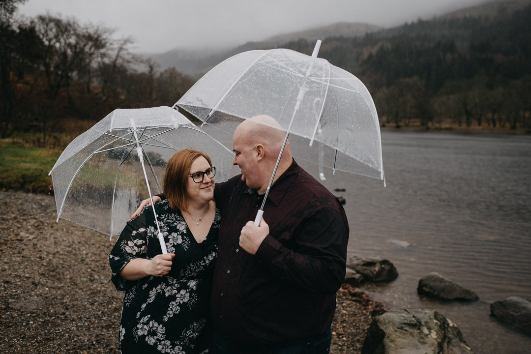 Romantic rainy couples adventure session in the Scottish Highlands - at Loch Lubnaig with umbrellas