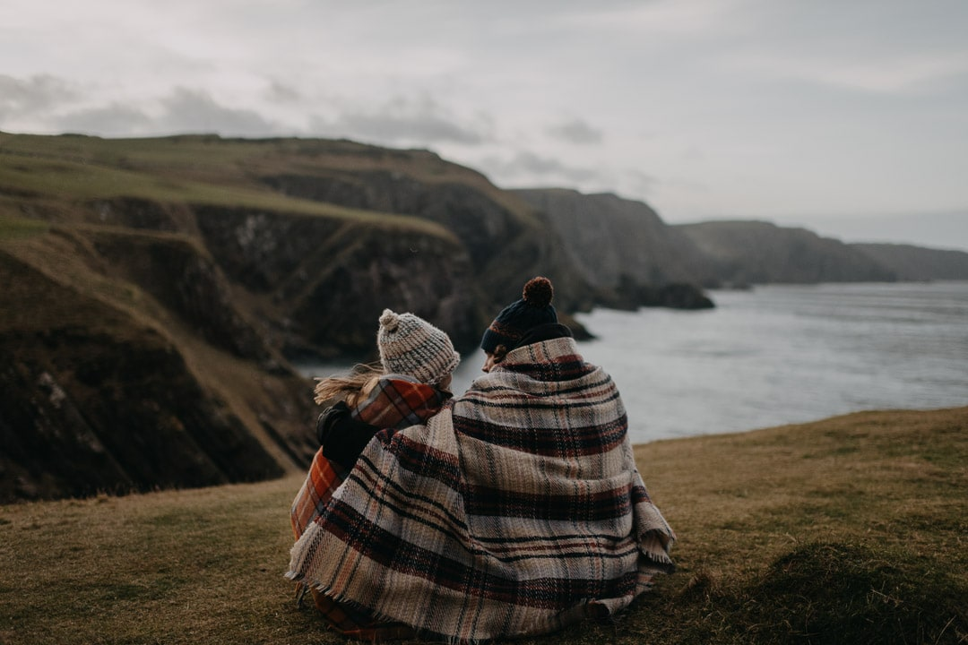 Proposal location in Scotland - cute couple cuddled up at St Abbs