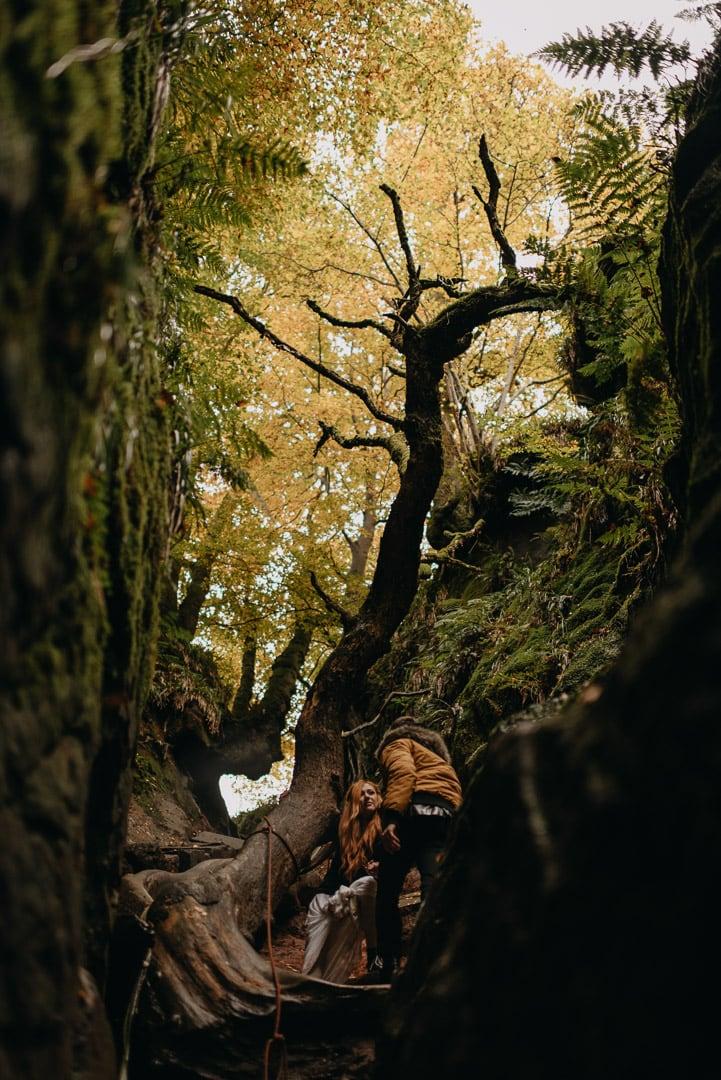 adventurous couple rock climbing in Devil's Pulpit elopement in Scotland