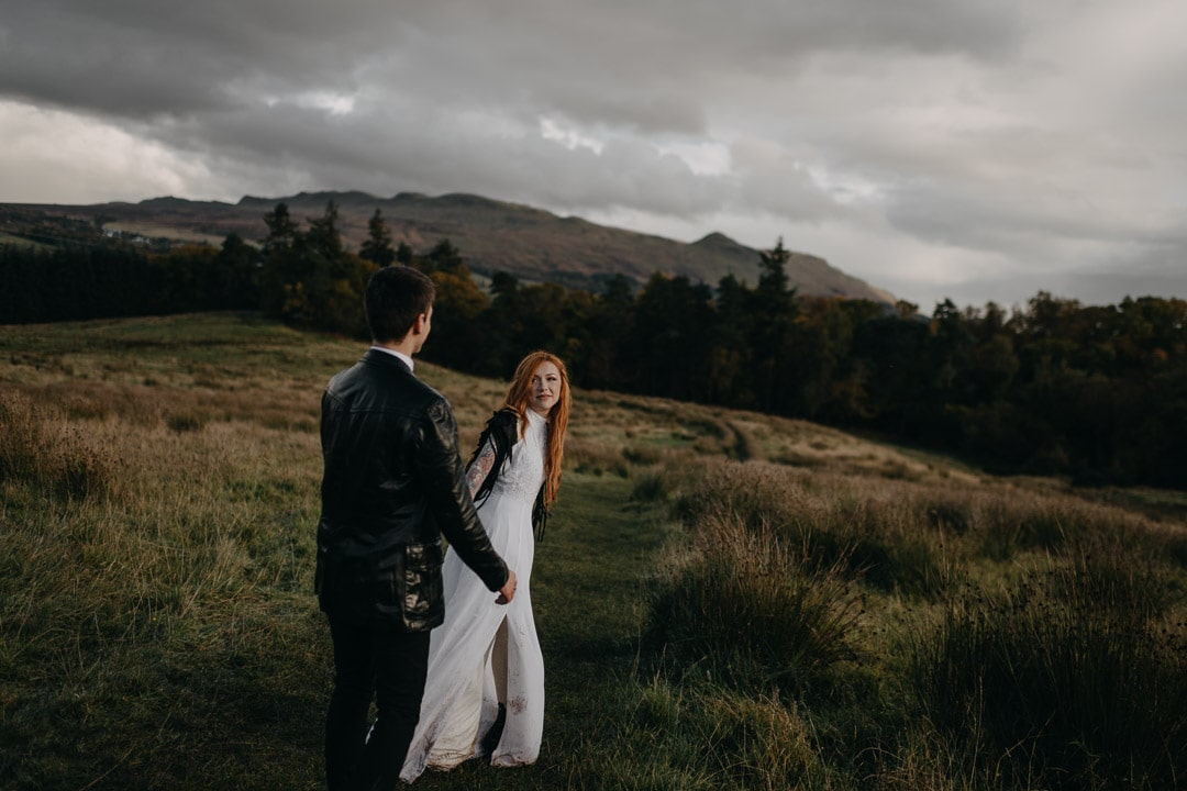 Rock n roll tattooed bride in adventurous Scotland elopement - dancing