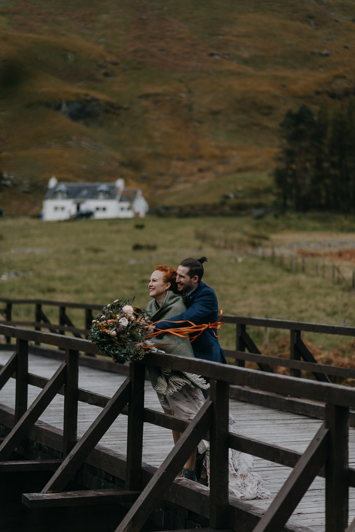 Romantic glencoe adventure elopement couple with white cottage
