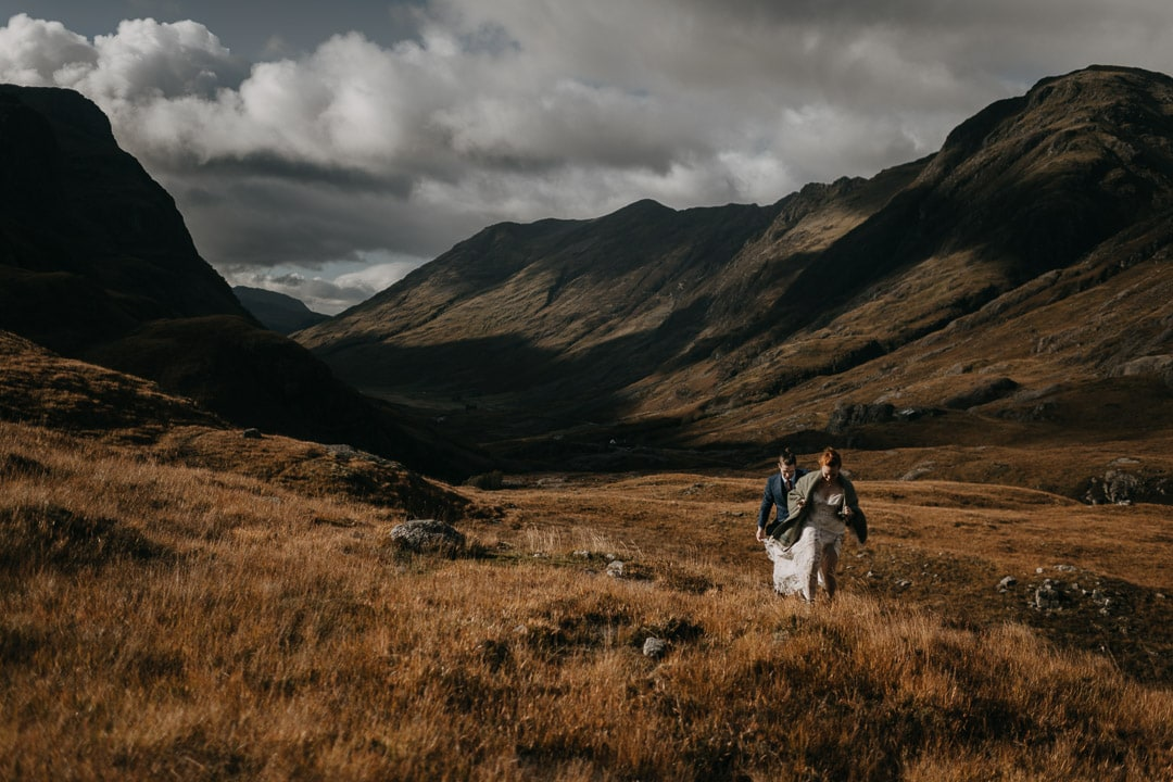 Eloping couple in windy Glencoe - dramatic scenery