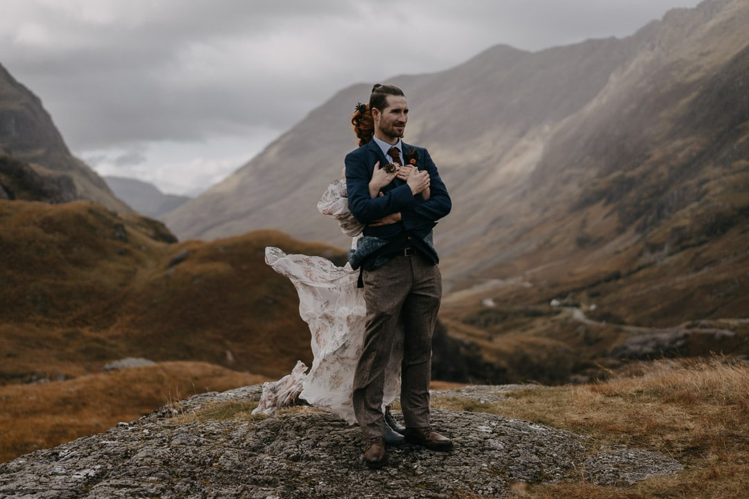 Romantic glencoe elopement couple windy