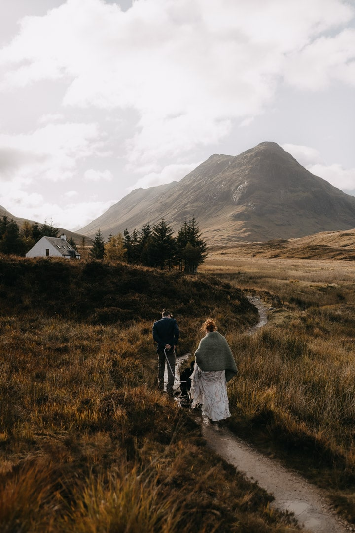 Romantic glencoe elopement couple going to white cottage