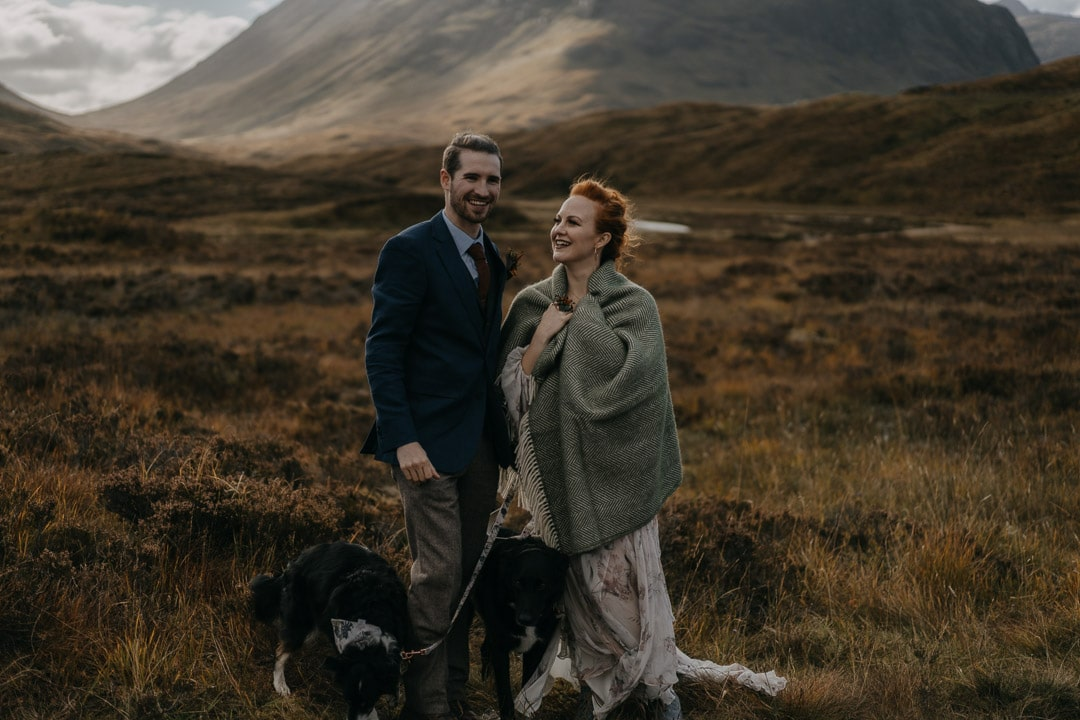 Romantic glencoe elopement couple with dogs