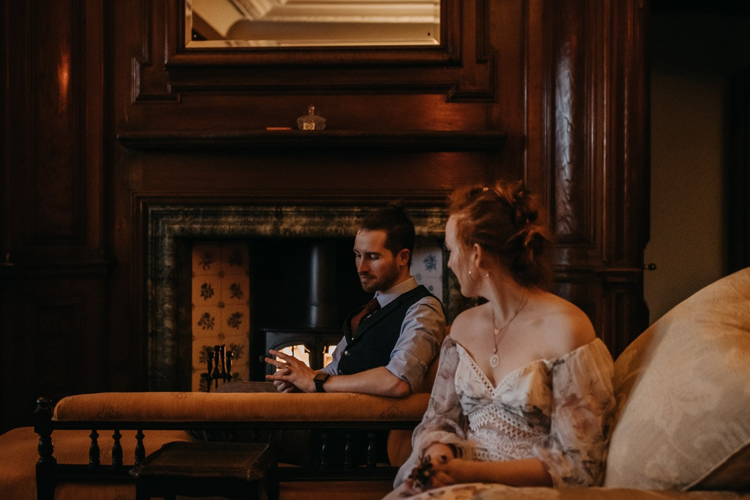 Glencoe house elopement - sharing a dram of whisky