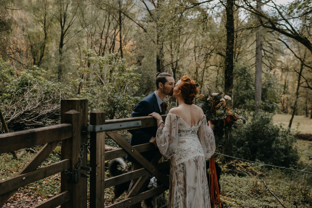 Glencoe elopement forest couple - kissing gate