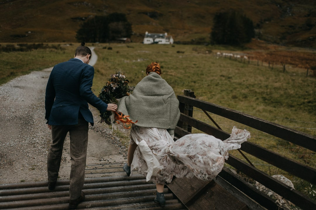 Romantic glencoe elopement couple with white cottage