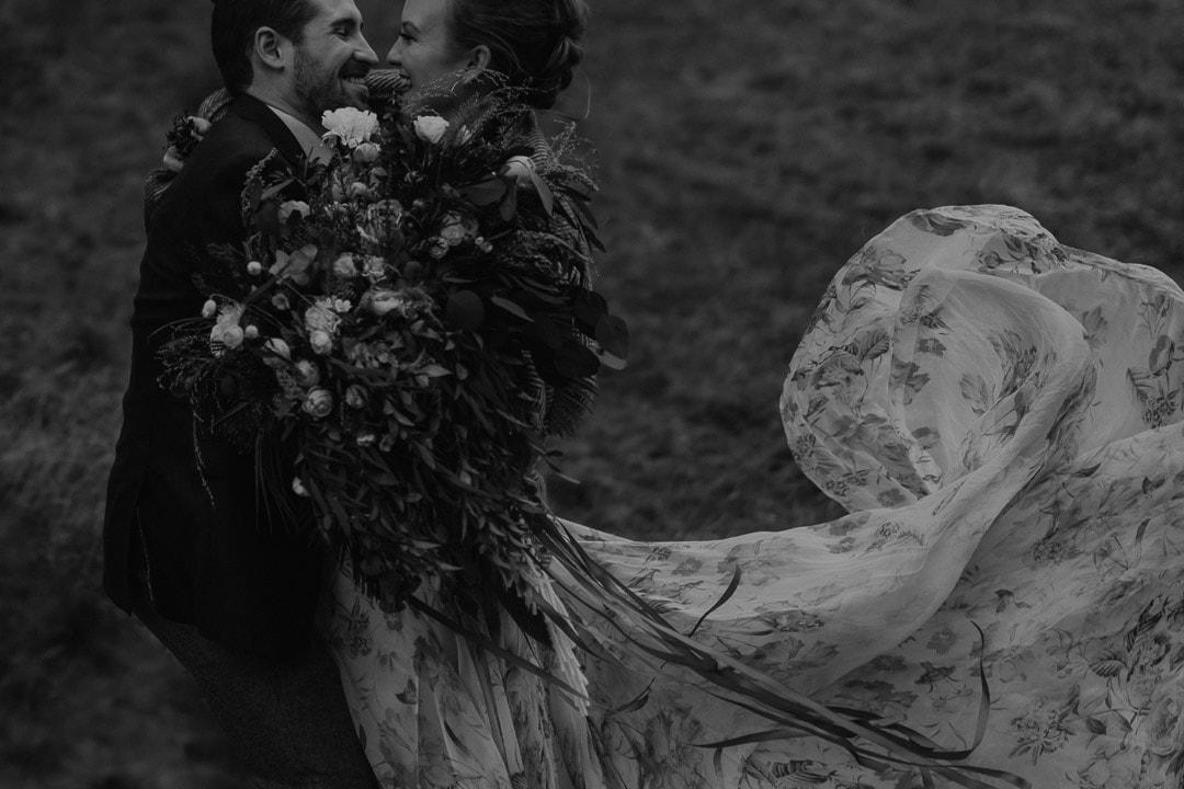 Romantic glencoe elopement couple windy